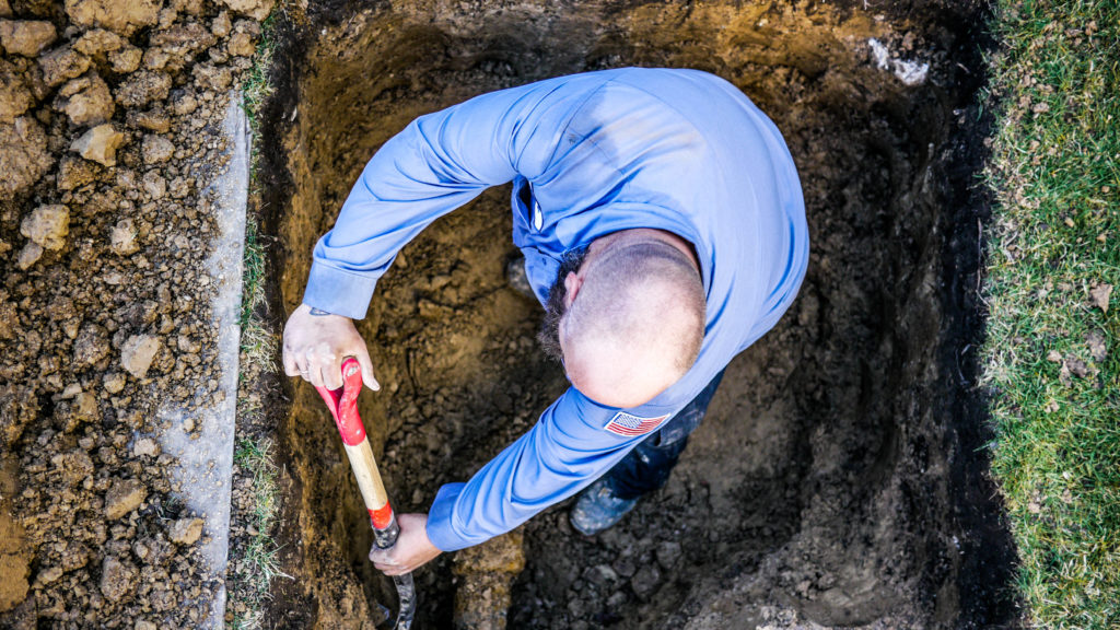 The Scottish Plumber digs up a broken sewer.